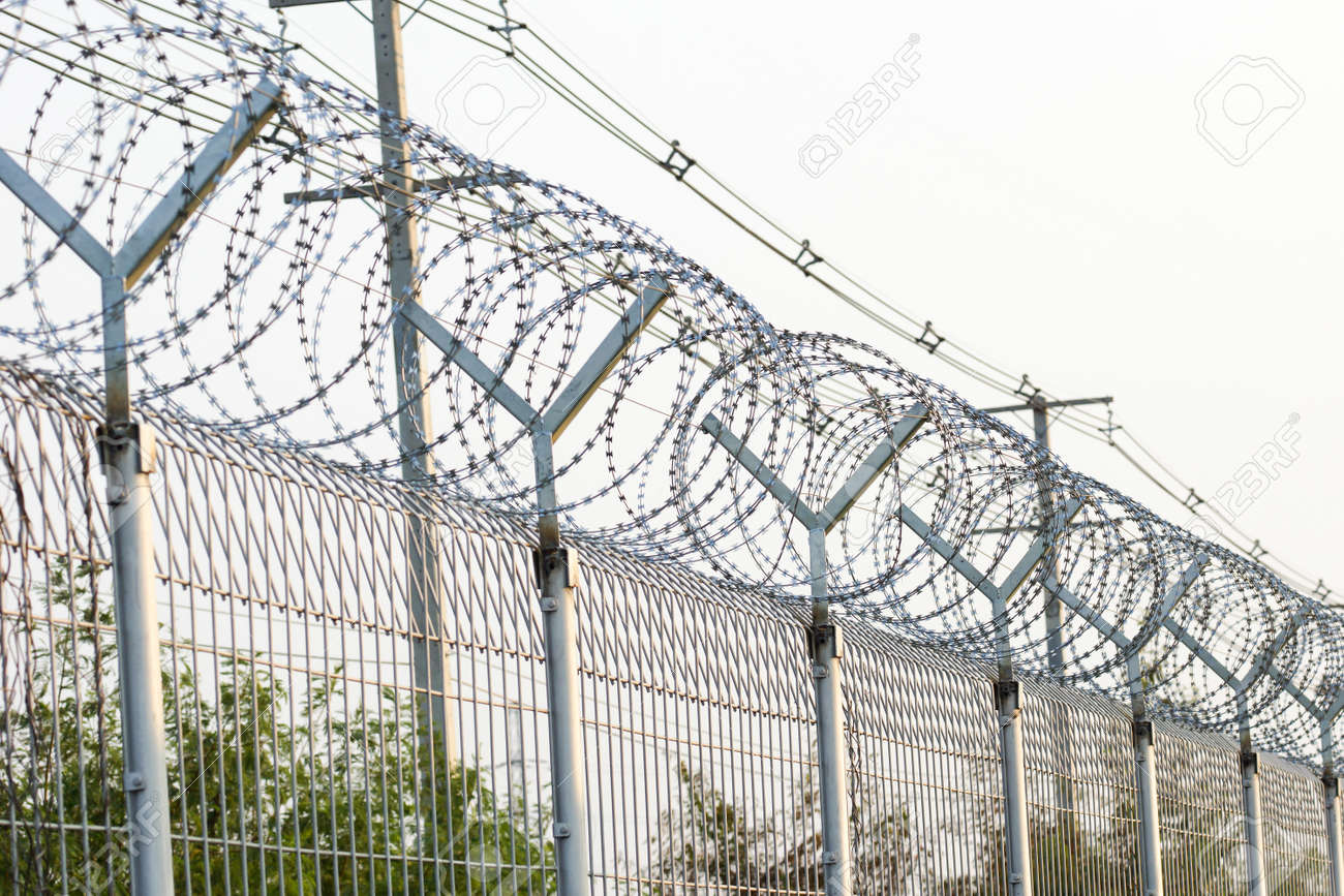 Barbed Razor Wire Fence Stock Photo, Picture And Royalty Free Image ...