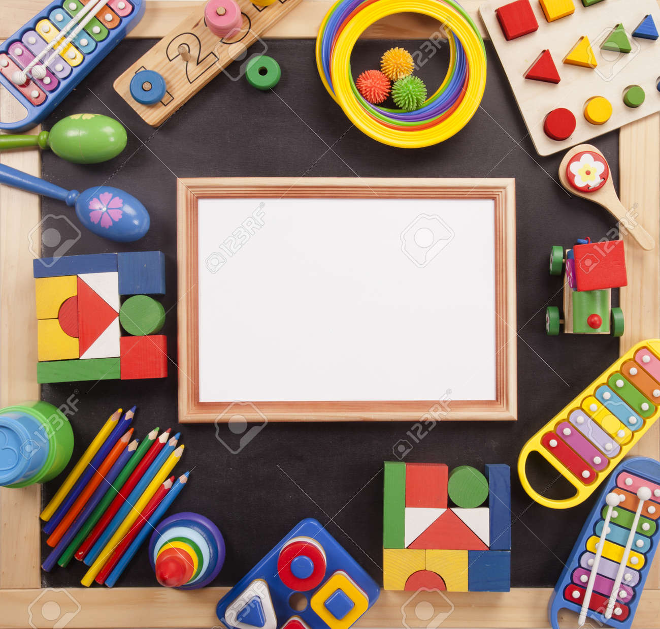 Color Toys Border On The Black Desk Stock Photo Picture And Royalty