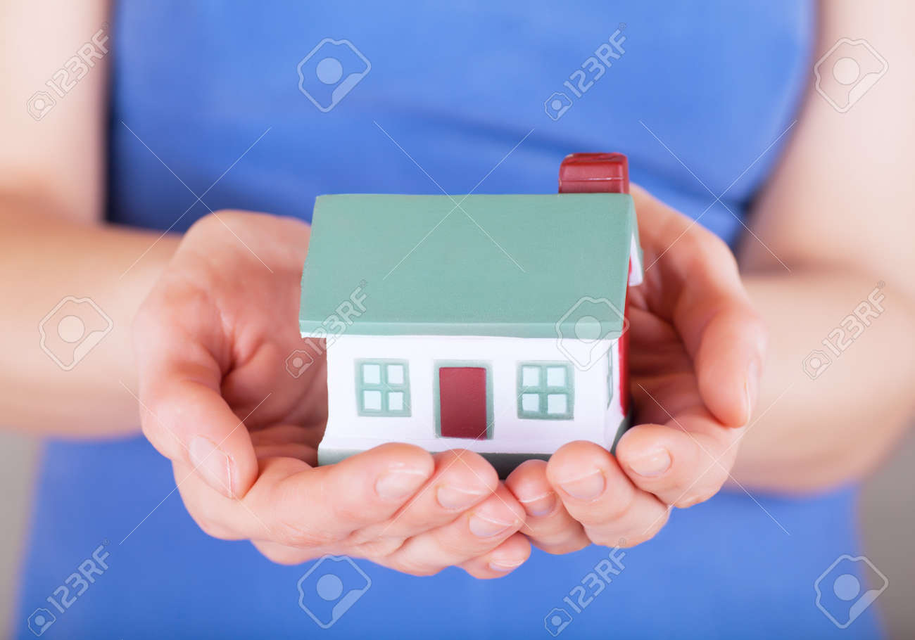 Little house toy in woman Stock Photo - 17612783