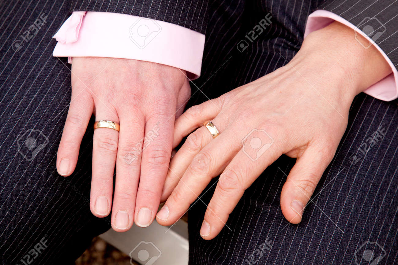 Two Female Hands With Wedding Rings On Homosexual Wedding Stock