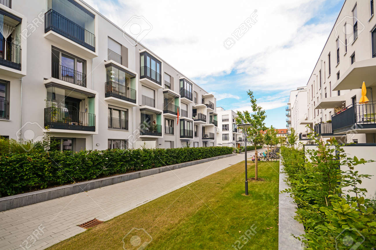 Modern residential buildings with outdoor facilities, Facade of new low-energy houses - 54545765