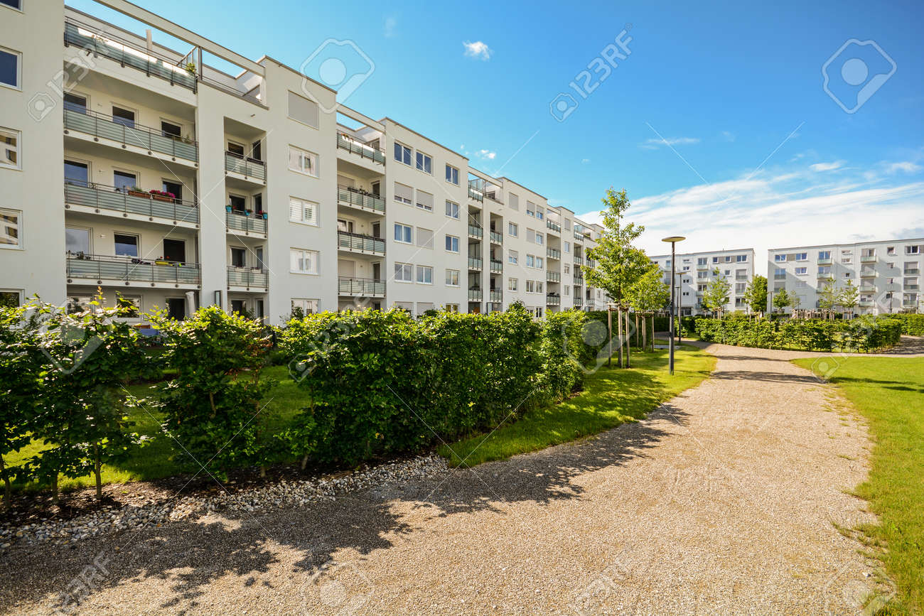 Apartment building in the city - Facade of new modern residential houses with low energy standard - 60481332