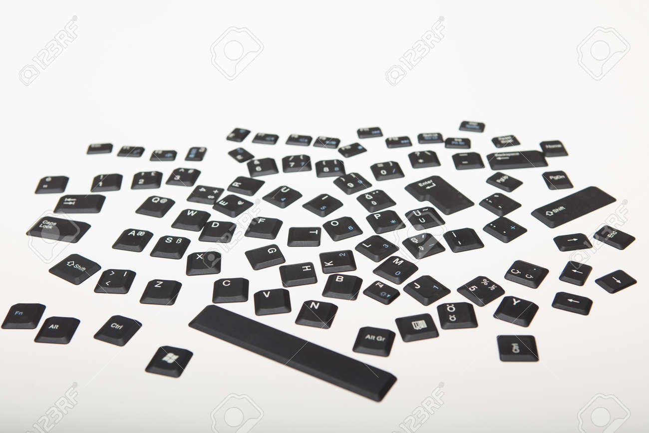 Loose alphanumeric covers for the keys on a computer keyboard