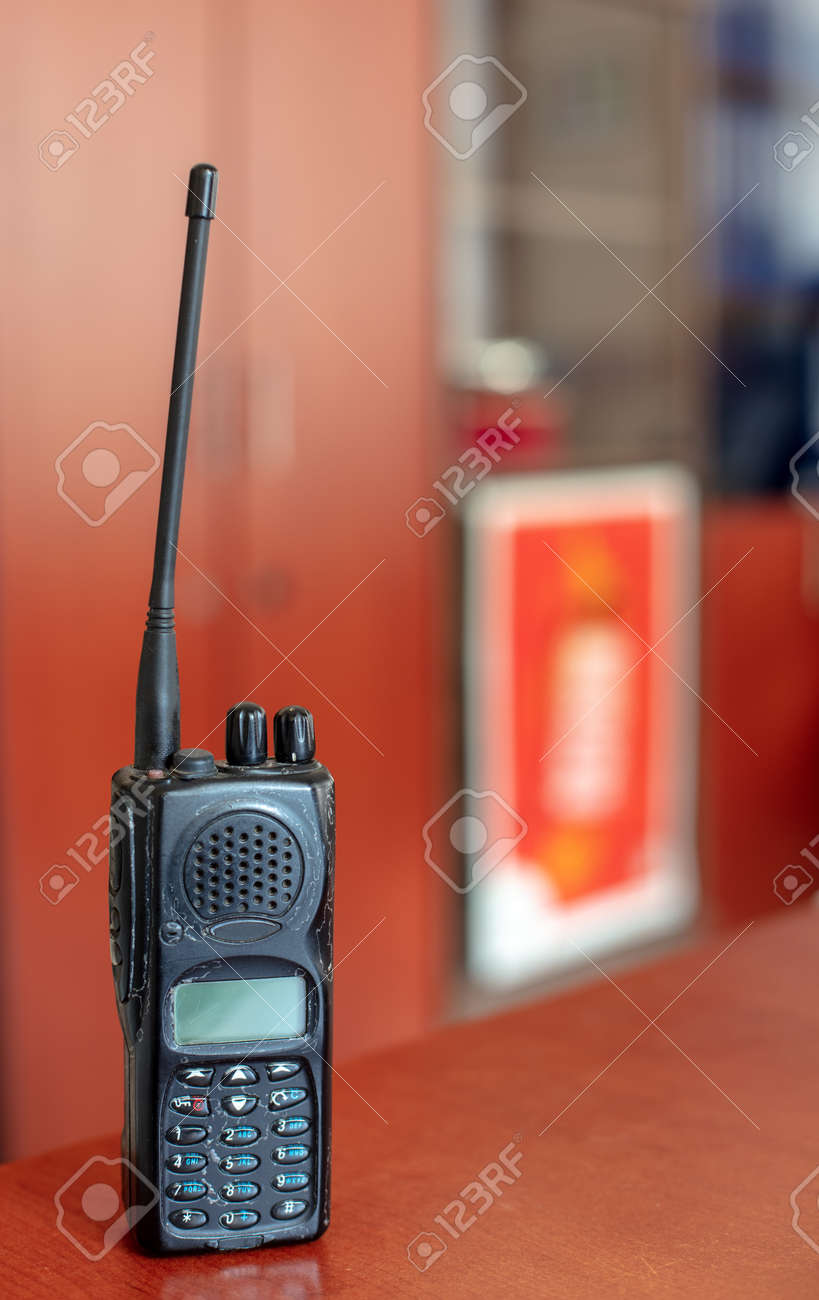 Old Walkie Talkie On Red Table And Blurred Background Communication