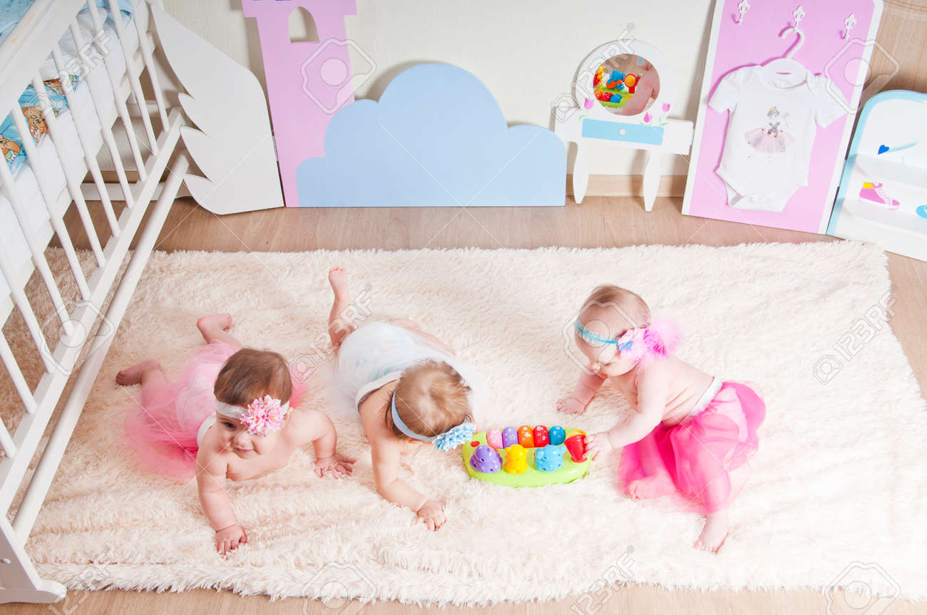 Picture of: Three Little Girls Playing In The Children S Room On The Carpet Stock Photo Picture And Royalty Free Image Image 60483770