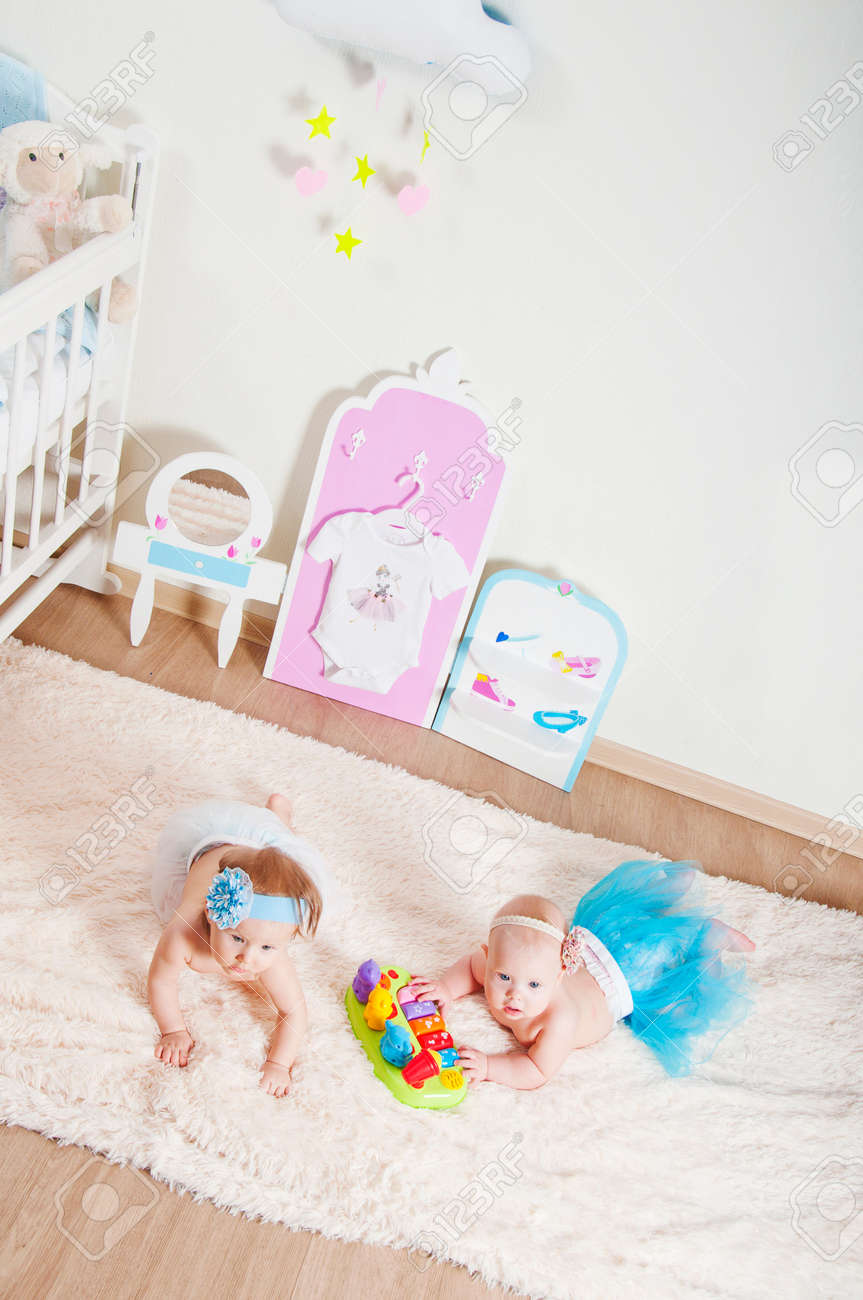 Picture of: Two Little Girls Playing In The Children S Room On The Carpet Stock Photo Picture And Royalty Free Image Image 64153505