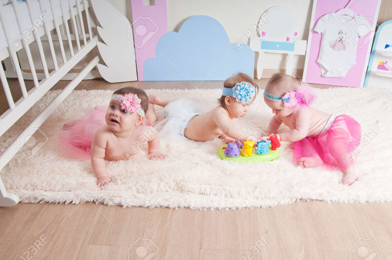 Three Little Girls Playing In The Children S Room On The Carpet Stock Photo Picture And Royalty Free Image Image 68913223