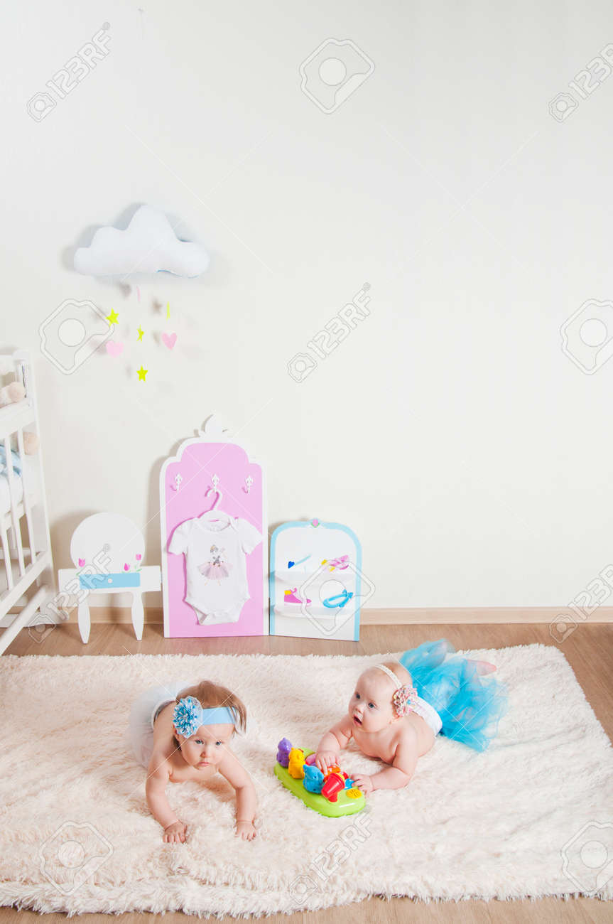 Picture of: Two Little Girls Playing In The Children S Room On The Carpet Stock Photo Picture And Royalty Free Image Image 70418427