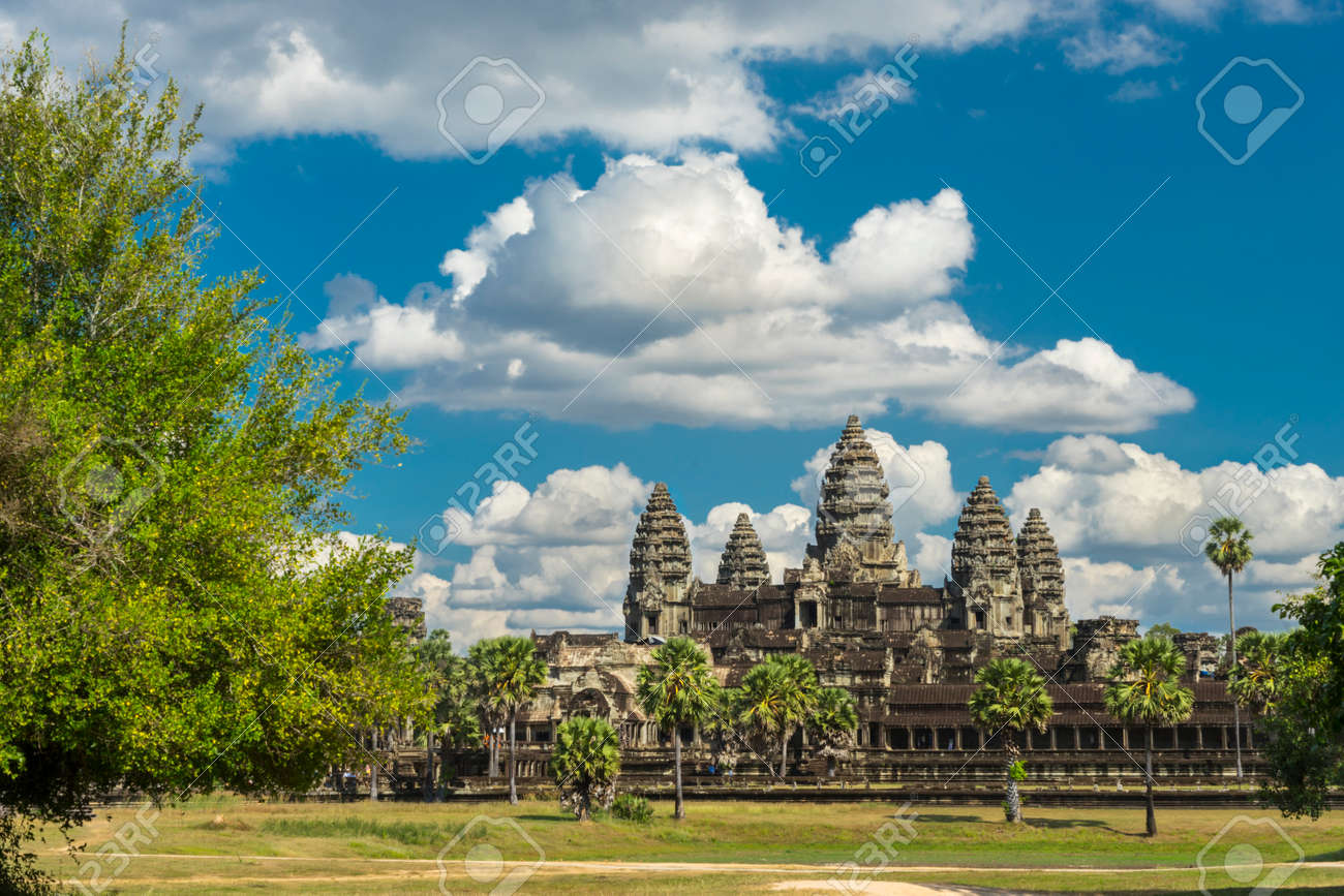 Ancient temple Angkor wat on a sunny day with horse, blue skay and many clouds in Siem Reap. Cambodia - 50164008