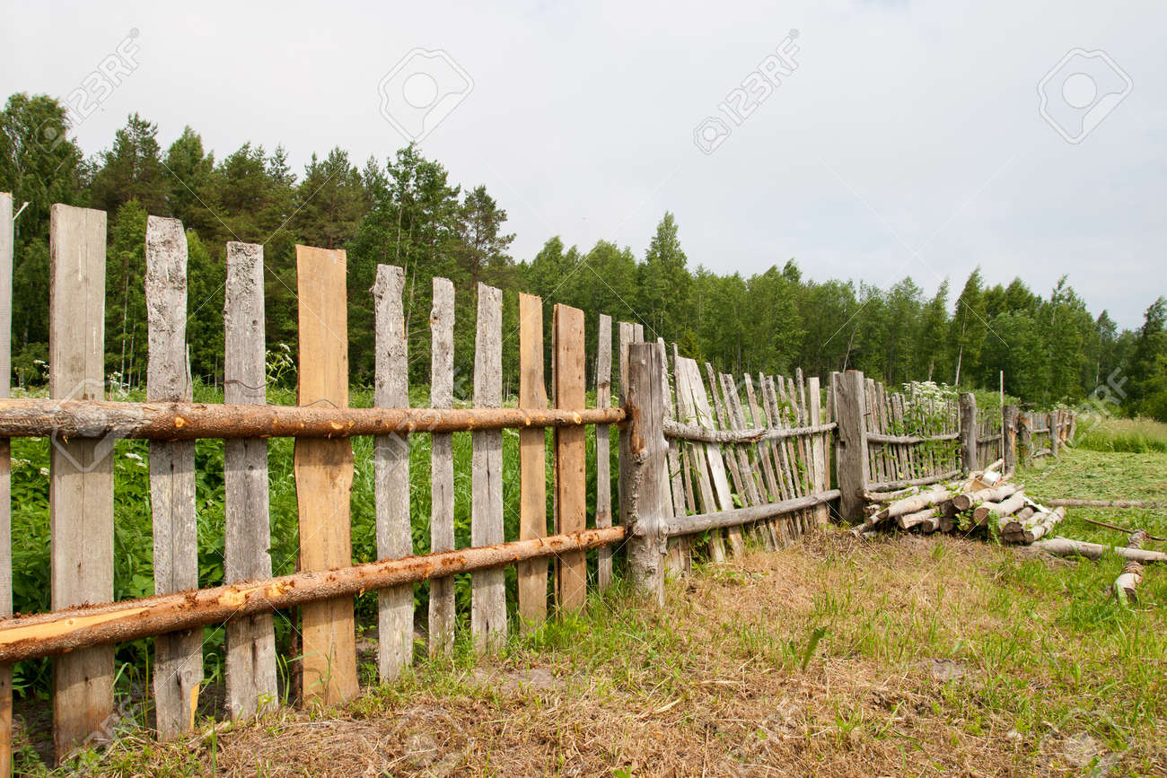 Old wooden fence repair at the countryside Stock Photo - 11936938