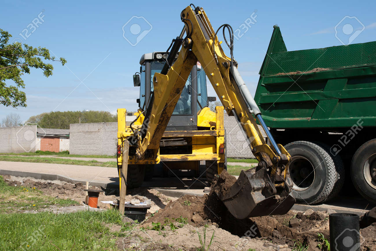 Excavator loading dumper truck tipper with sand on construction site Stock Photo - 12395161