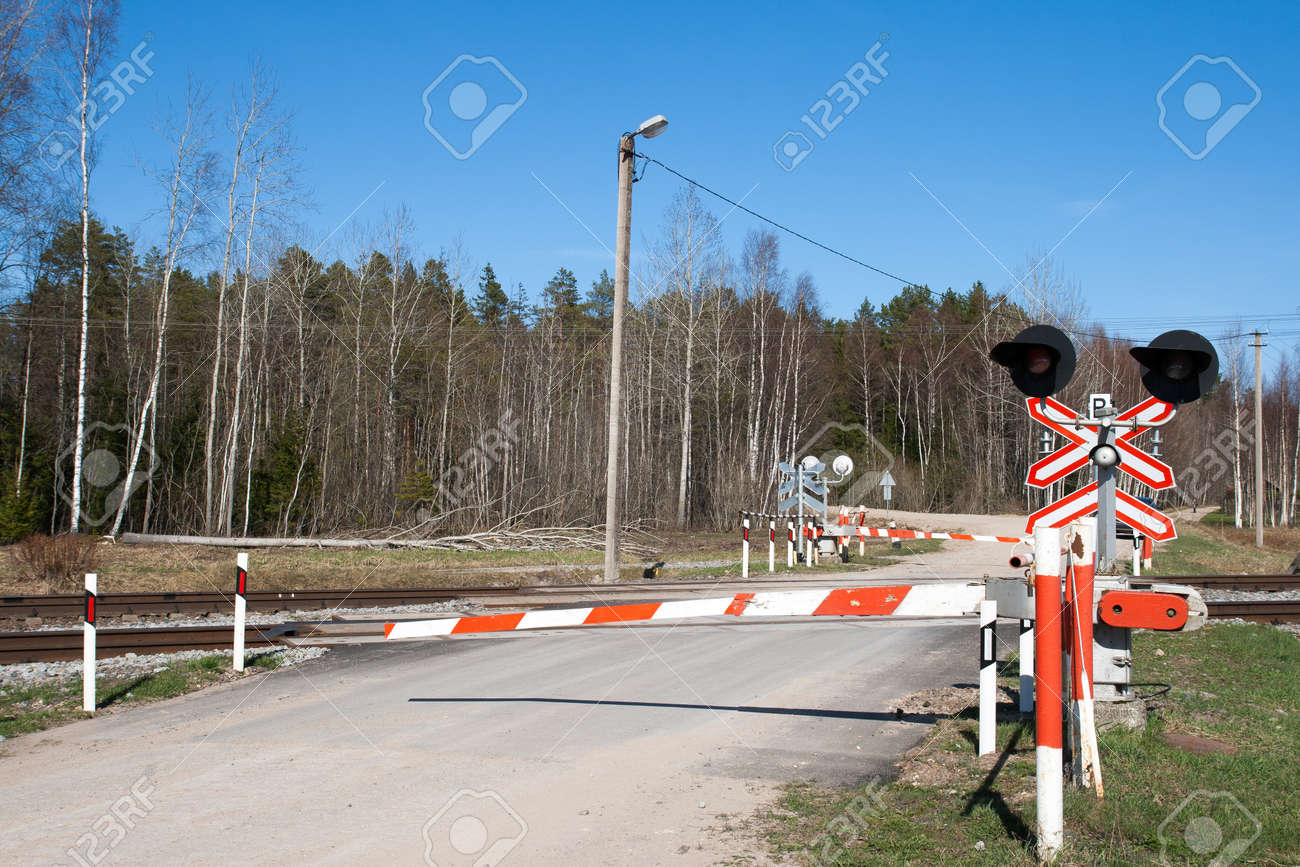 railway crossing on a country road Stock Photo - 14282668
