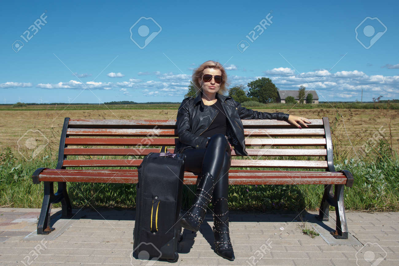 lonely bus stop at countryside with women on bench Stock Photo - 14746769