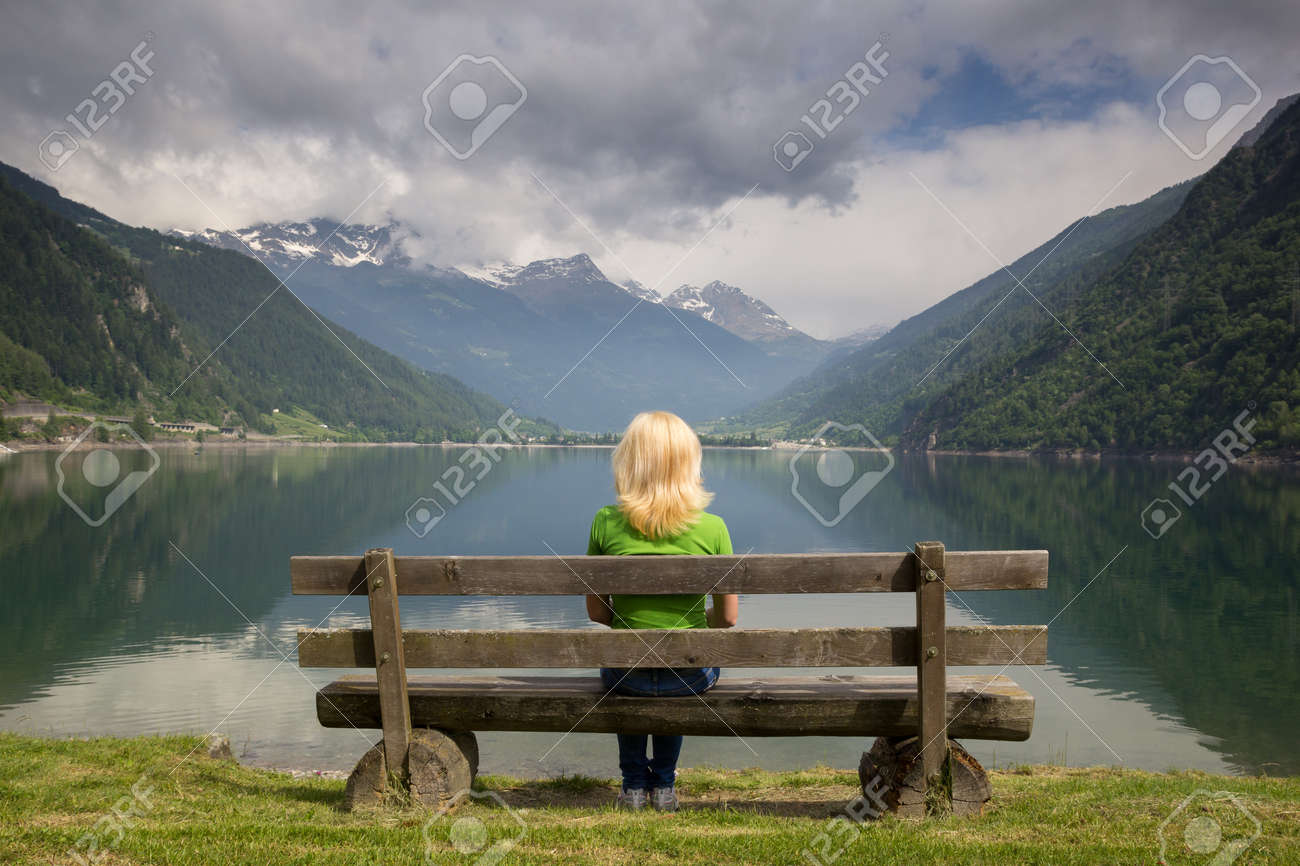 bench in the high mountains at the lake Poschiavo, Switzerland Alps Stock Photo - 15897051