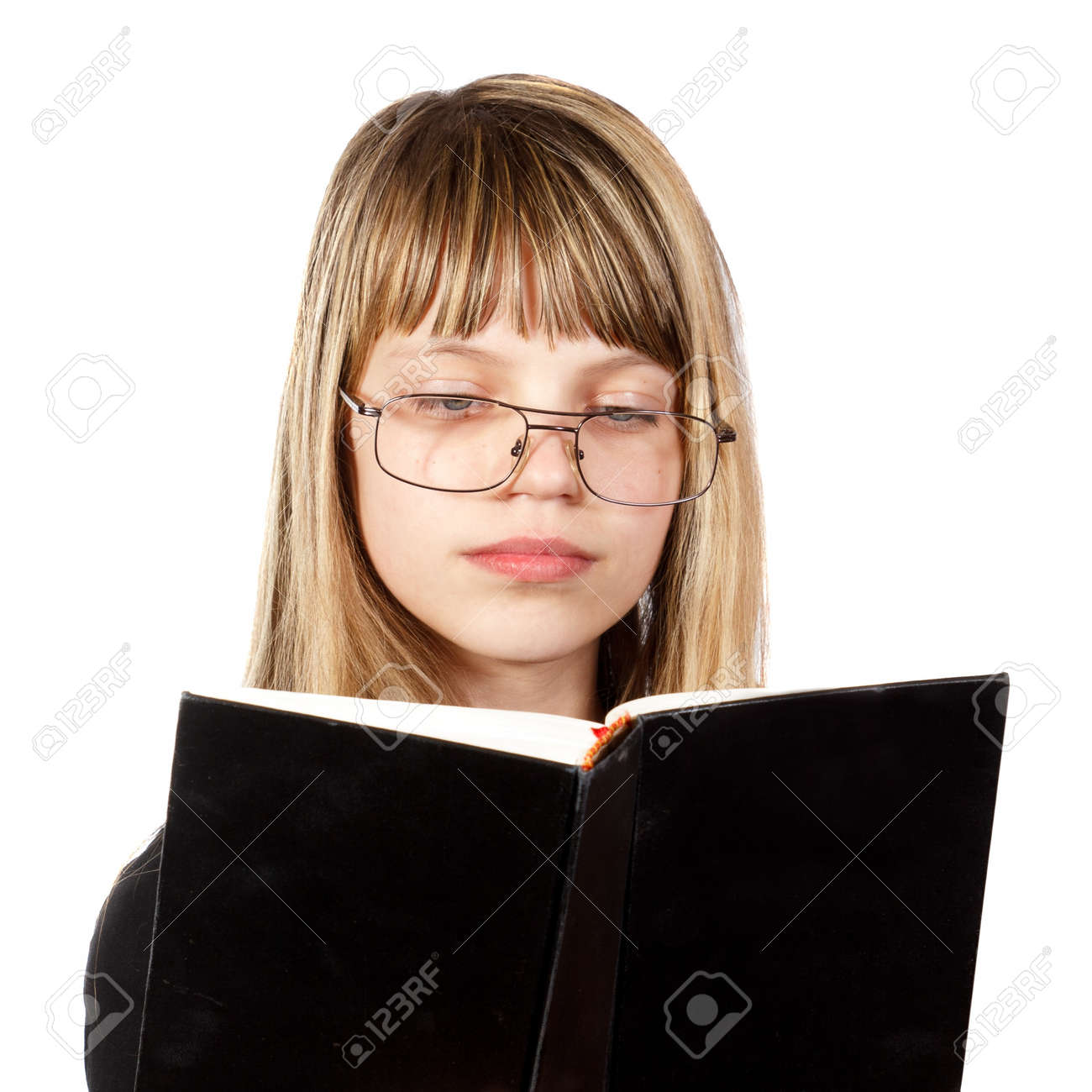 1cee1d28272a teenage girl with big glasses reading a black book against white background  Stock Photo - 17109366