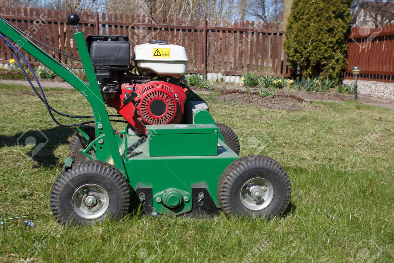 Lawn Aerator.A Lawn Aerator Is A Garden Tool Or Machine Designed To Aerate  The