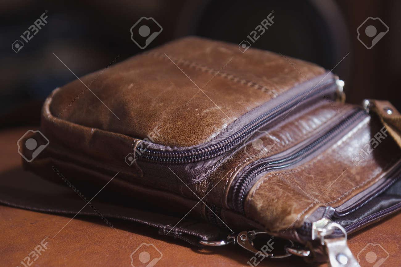 Admirable Brown Leather Mens Handbag Lying On Chair Ibusinesslaw Wood Chair Design Ideas Ibusinesslaworg