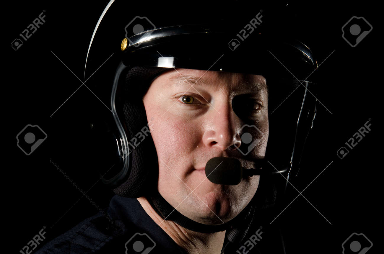 A motorcycle police officer in the night. Stock Photo - 12035752