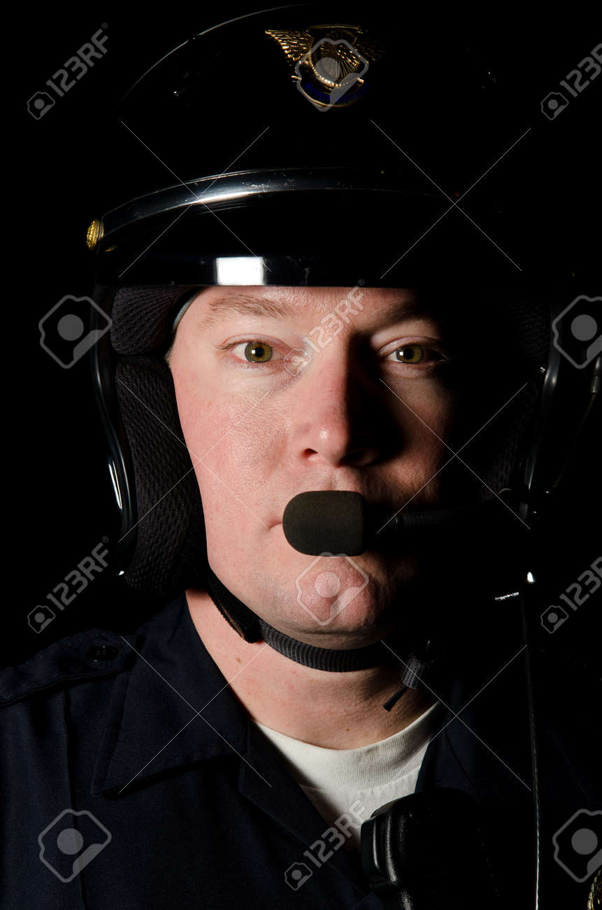 A motorcycle police officer in the night.  Stock Photo - 12035100