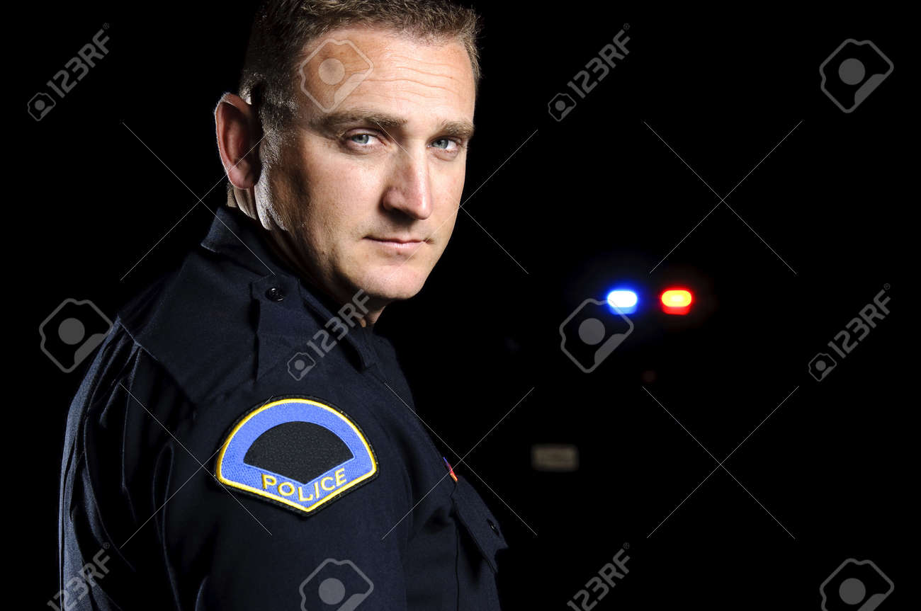 a police officer standing in the night during a patrol shift. Stock Photo - 12062062