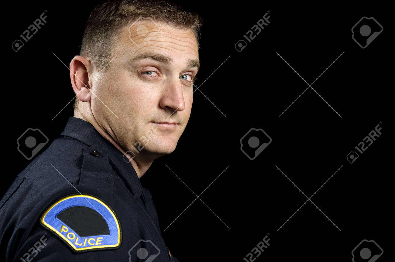 a police officer standing in the night during a patrol shift. Stock Photo - 12062067