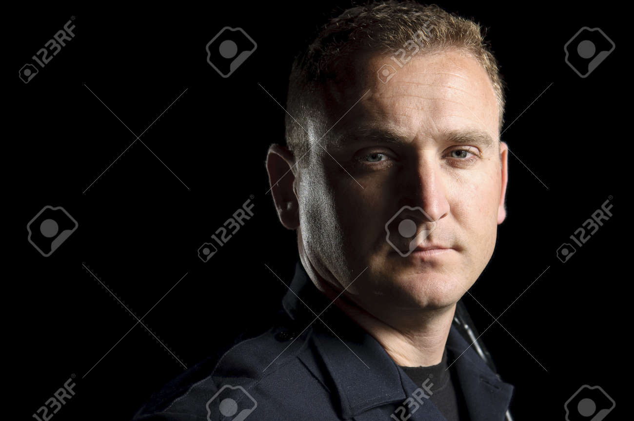 a police officer standing in the night during a patrol shift. Stock Photo - 12062071