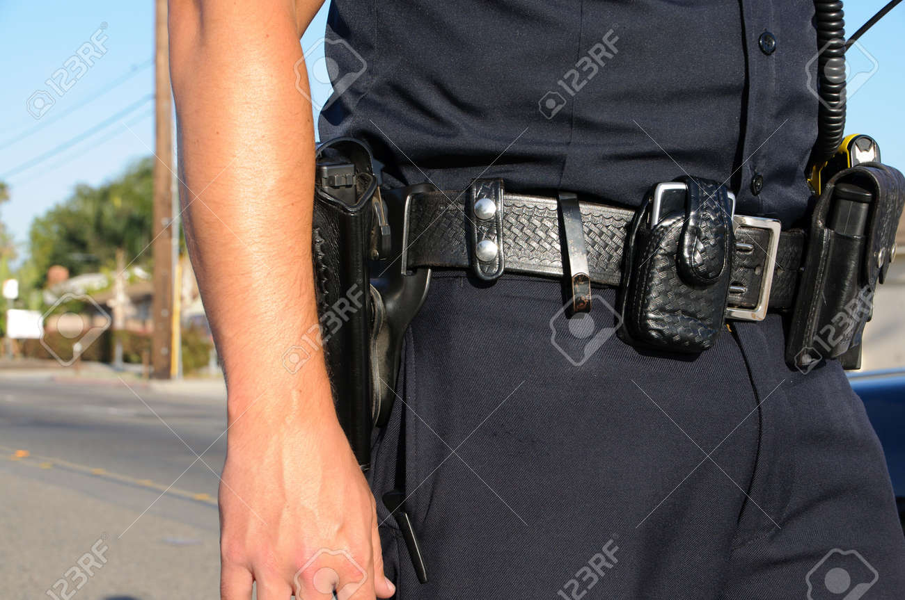 a police officer standing in the street on a call. Stock Photo - 12381939