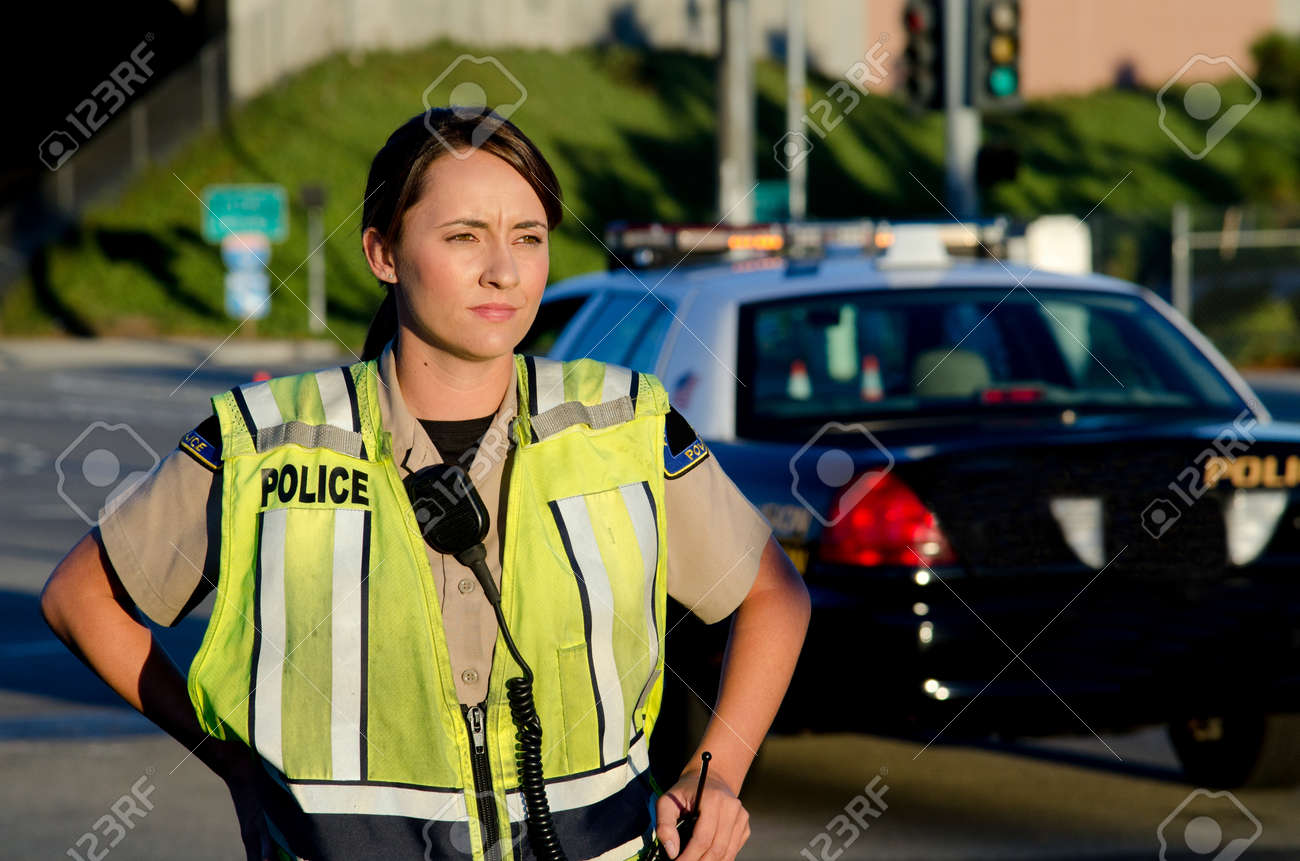 A female police officer staring and looking serious during a traffic control shift Stock Photo - 15401225