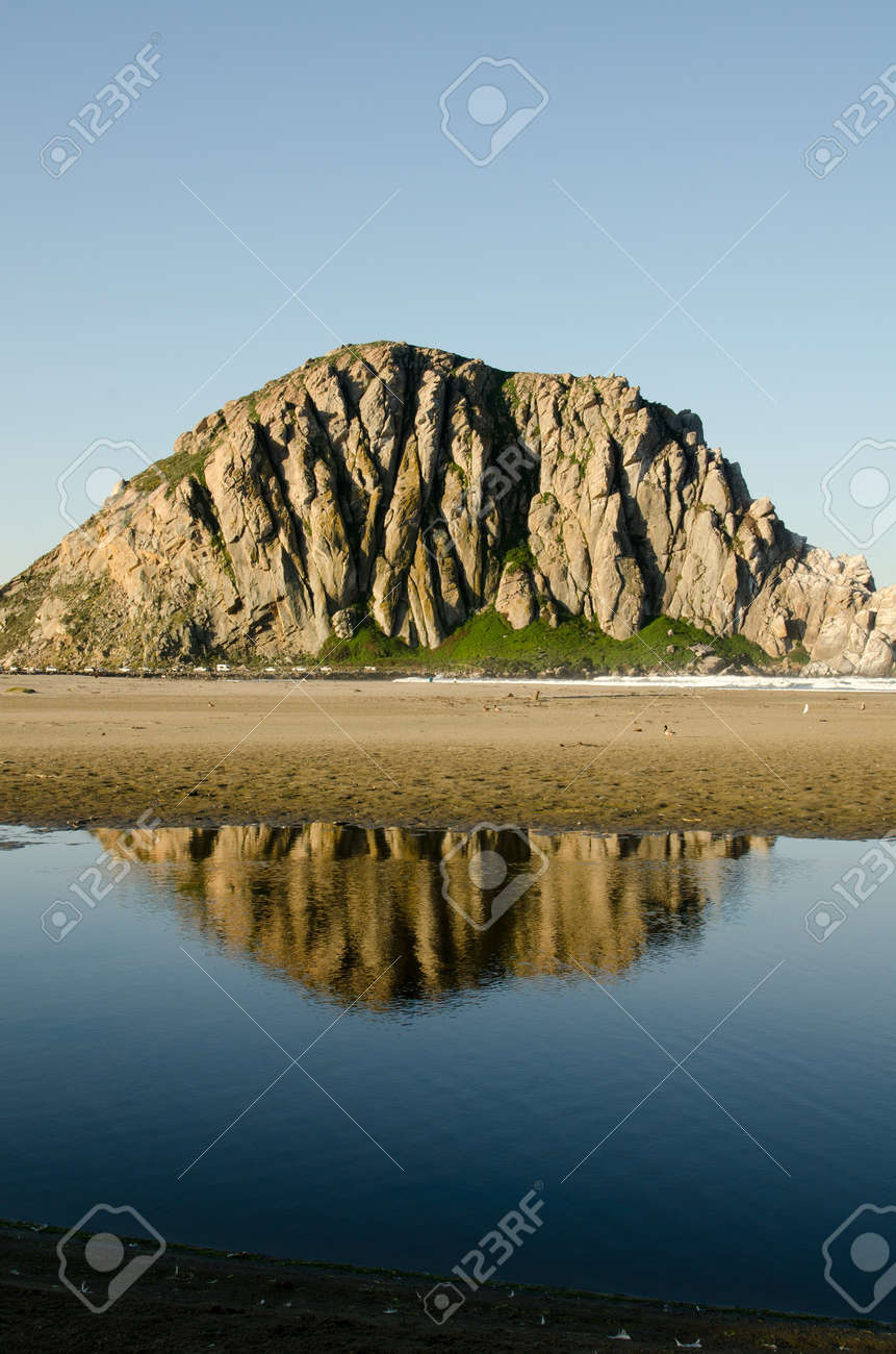 The reflection of Morro Rock in Morro Bay, CA along the Central Coast. Stock Photo - 18860260