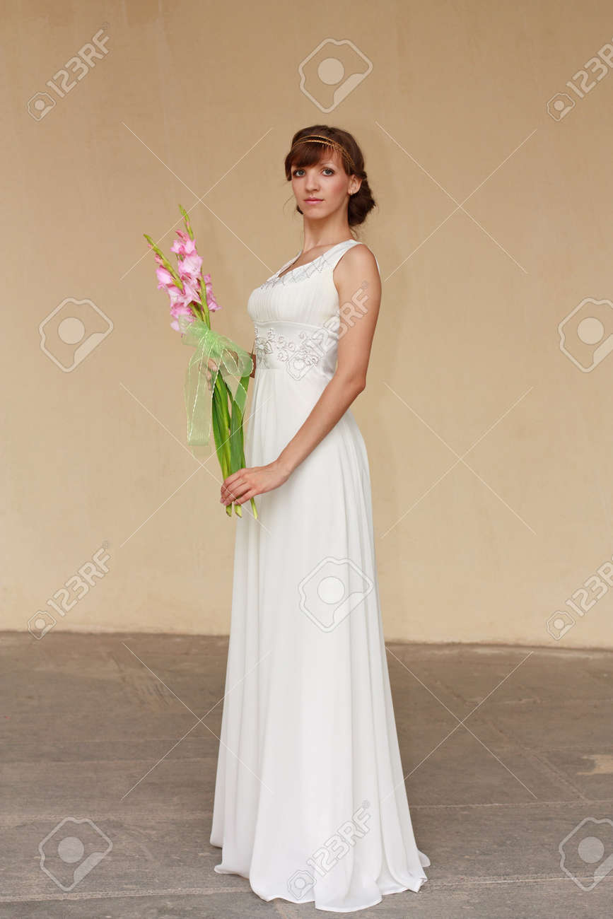 Portrait Of Beautiful Greek Woman Posing In White Dress With Stock