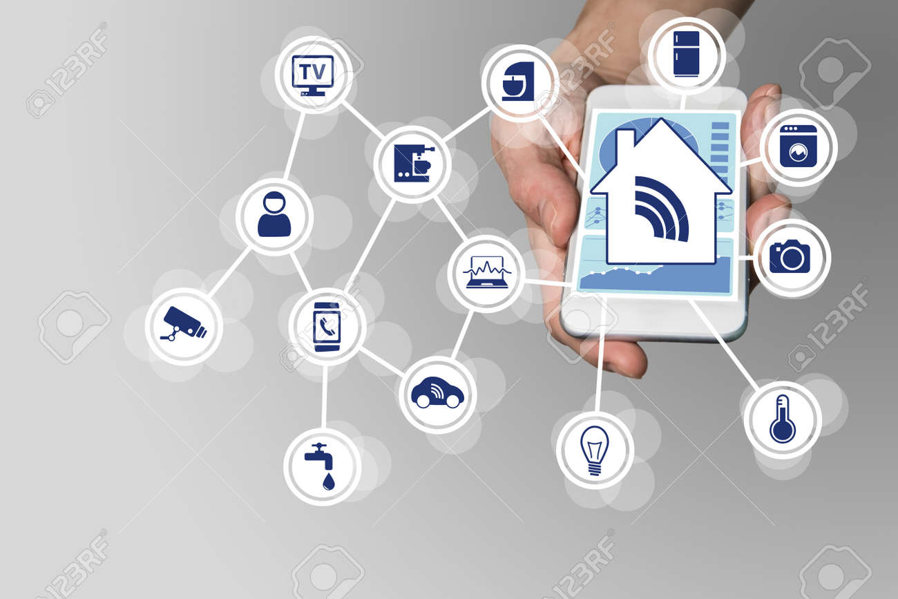 Hand holding modern smart phone on neutral background. Smart home automation concept with connected devices - 53754039