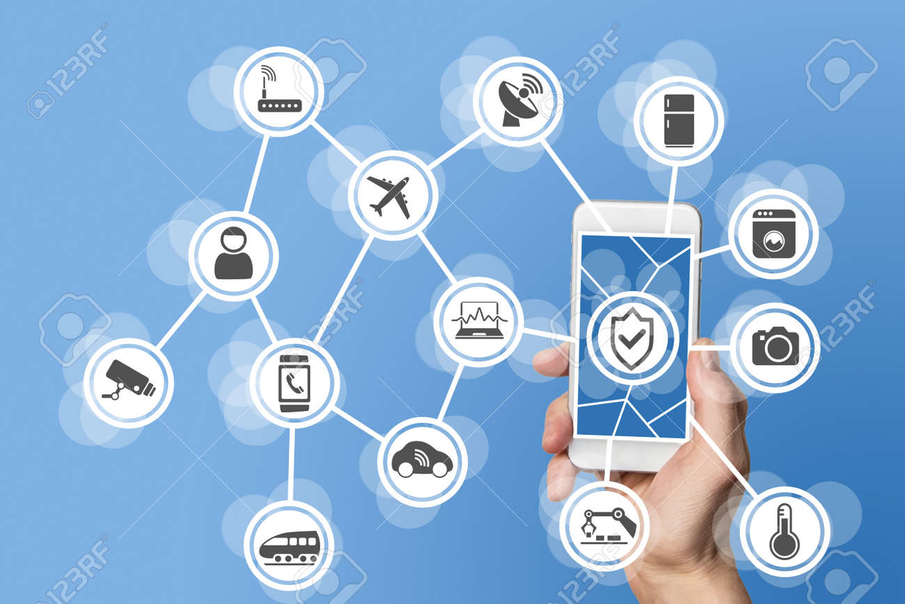 Internet of things security concept illustrated by hand holding modern smart phone with connected sensors in objects. - 52473658
