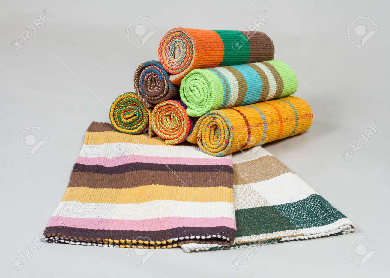 Stock Photo   Striped Colorful Table Runners On Gray Background
