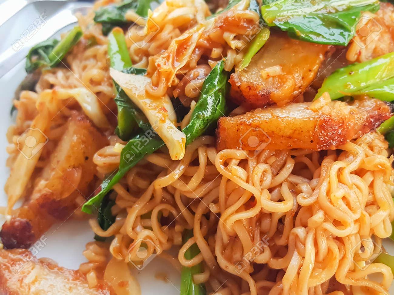 Thai food stlye:Spicy Stir fried instant noodle &fried pork curry