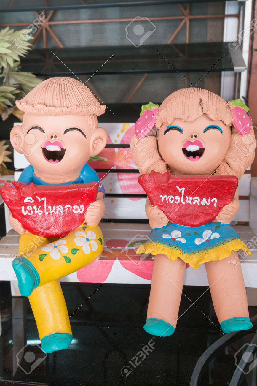 Close Uphappy Dolls For Garden Decoration Have Greeting In Thai