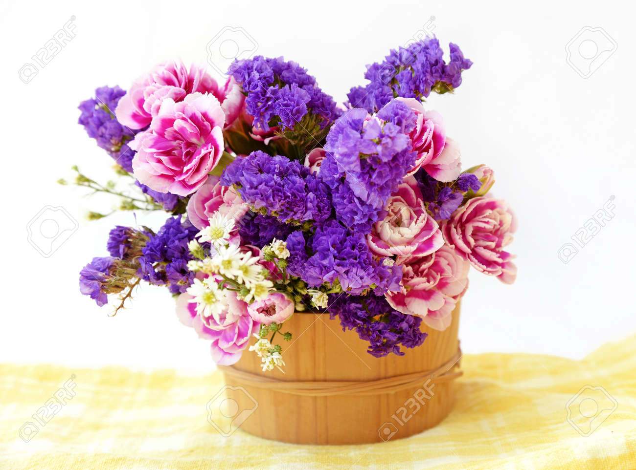Bunch Pink And Blue Flowers In Wooden Bucket Isolated On White Stock Photo Picture And Royalty Free Image Image 40575174