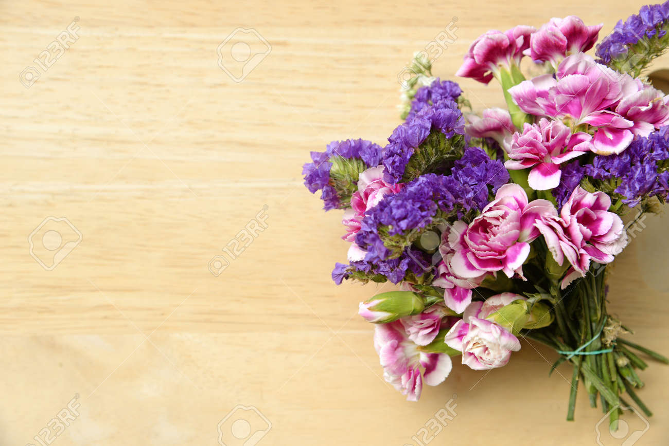 Bouquet Of Wild Summer Flowers On Wooden Table Stock Photo, Picture ...