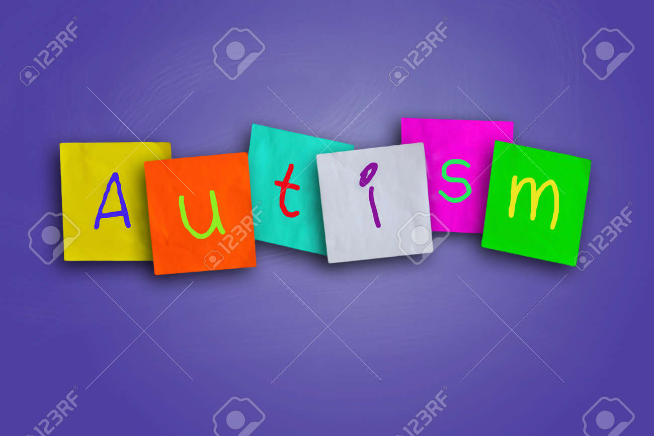 paper on autism the word autism written on sticky colored paper stock photo stock photo the word autism written