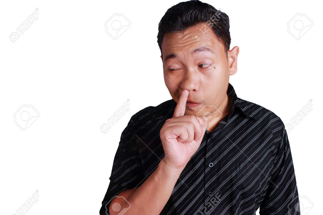 Image of man picking nose