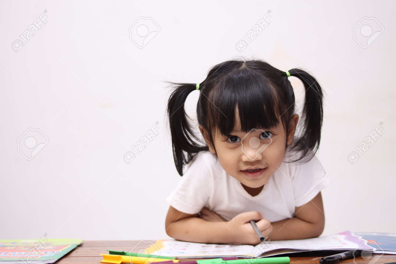 Cute adorable little Asian baby girl with pony tail hair looking at camera and smiling, happy joy excited expression when learning at home - 149877407