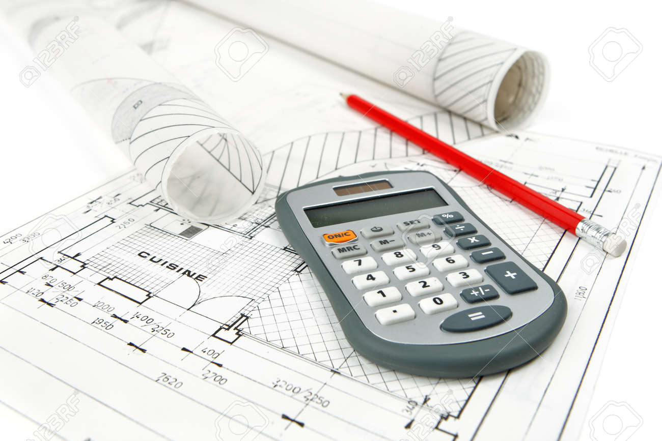 Close-up of calculator and pencil placed on home improvement plans with rolls of architectural drawings. Photo shoot isolated on white background. - 163654195