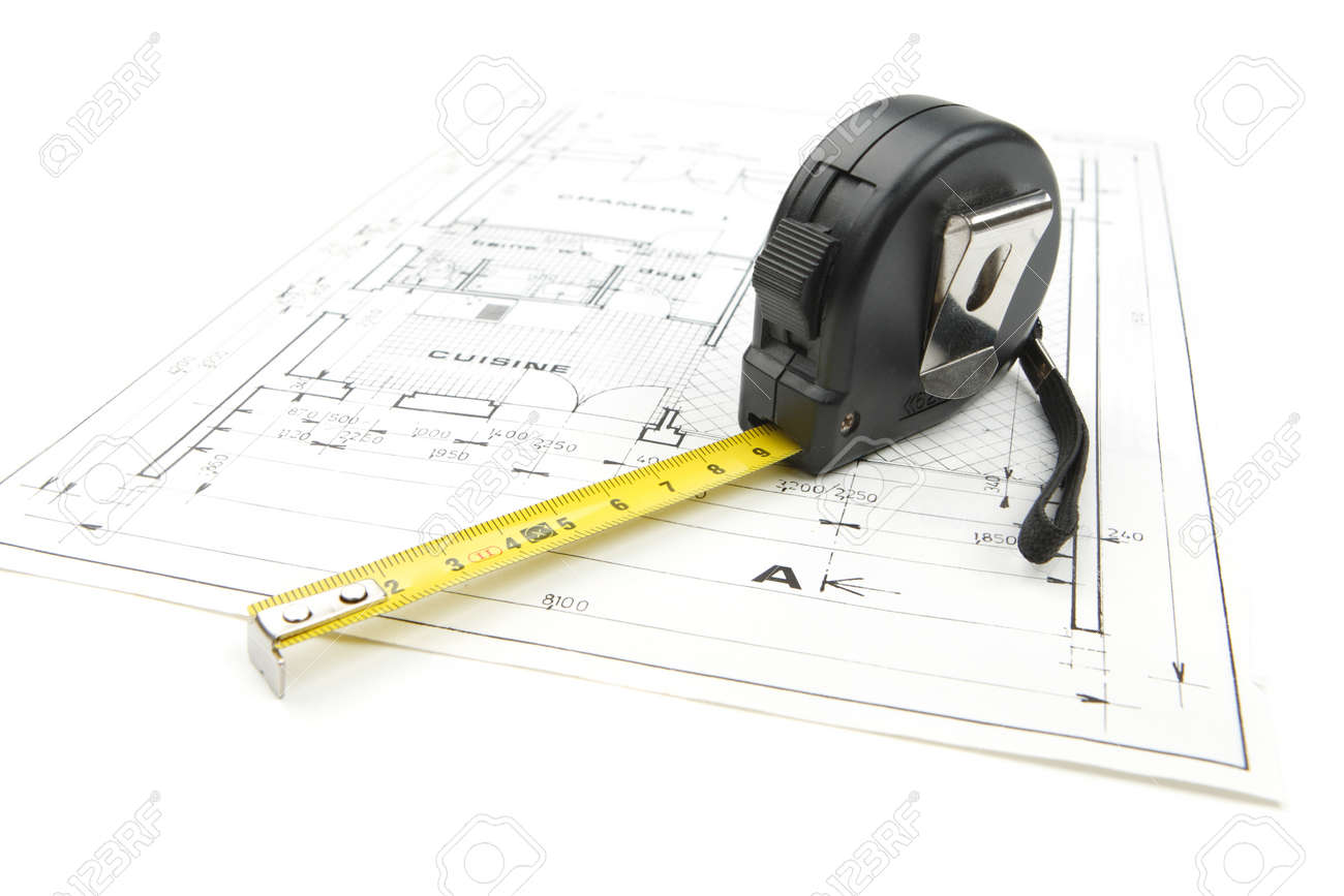 Architecture concept with black tape measure on a construction plan isolated on white background in studio - 163654541