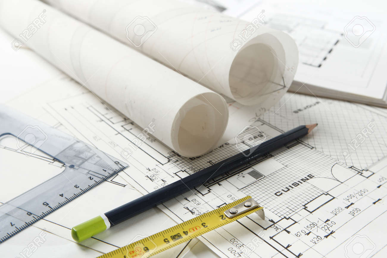Set of drawing work equipment laid on home and kitchen layout plans with rolls of architect drawings - 163654634