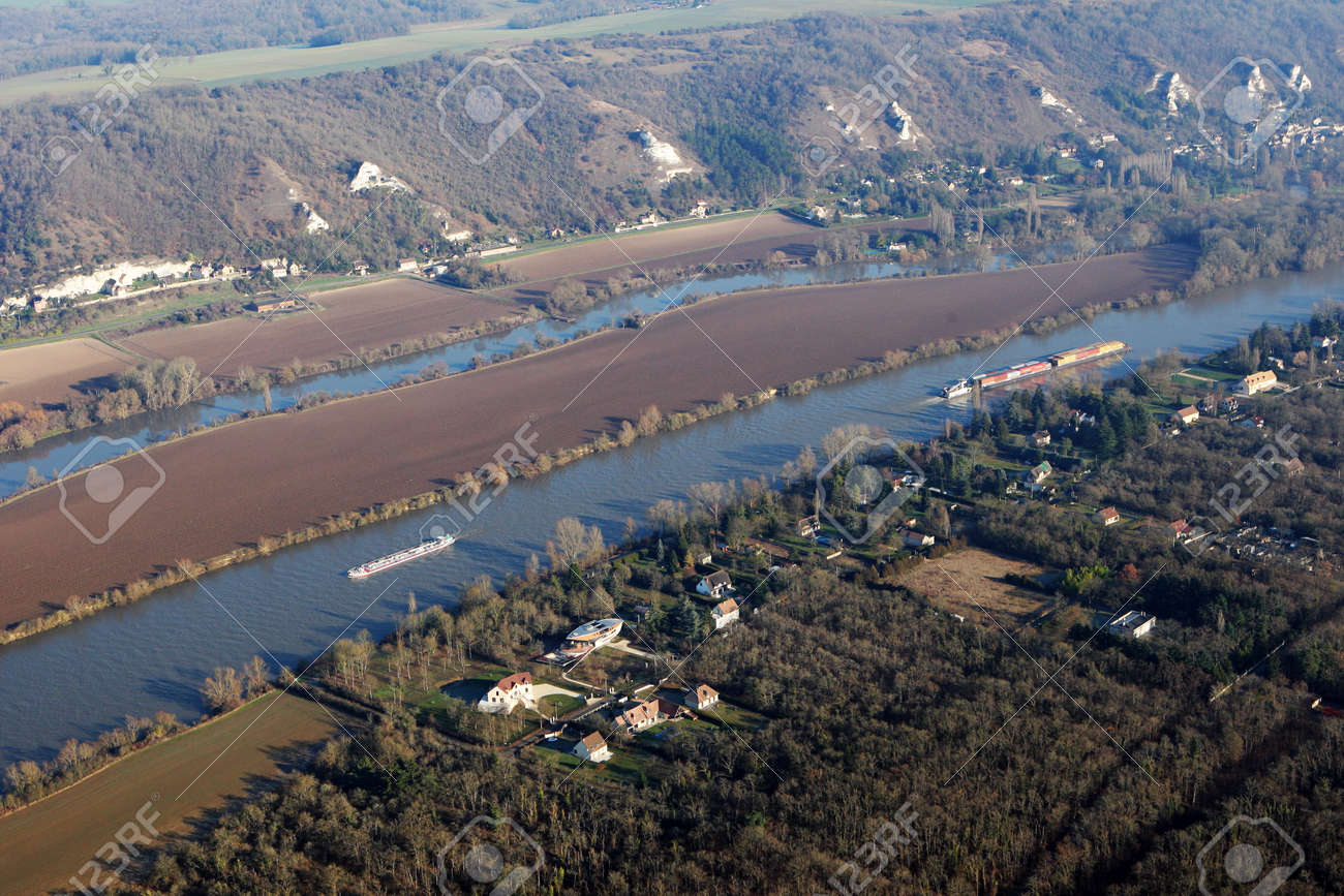 Aerial photography of barges and transport boats sailing on the Seine river, in commune of Haute-Isle en Vexin, Val-d'Oise department (95780), Ile-de-France, France - January 03, 2010 - 164479181