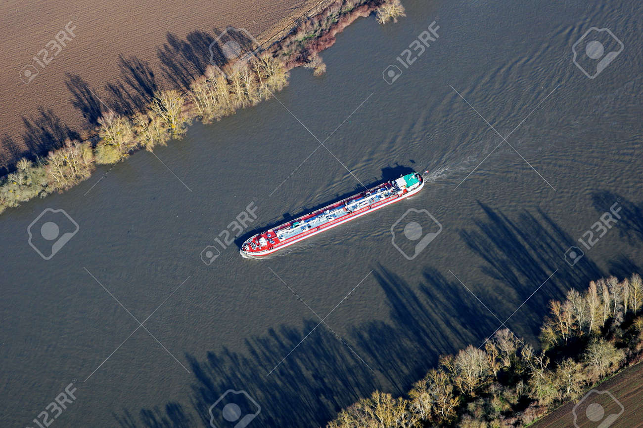 Aerial viwy of barges sailing on the Seine river, in commune of Haute-Isle en Vexin, Val-d'Oise department (95780), Ile-de-France, France - January 03, 2010 - 164479186
