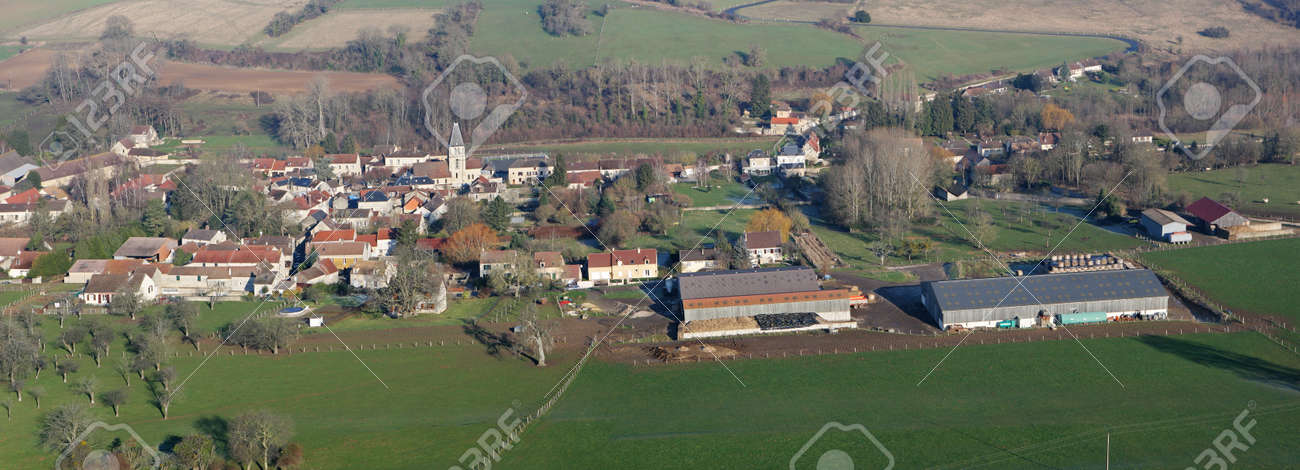 Panorama of Chaussy en Vexin seen from the sky, a small rural village with its agricultural farm, in Val-d'Oise department (95710); Ile-de-France region, France - January 03, 2010 - 164480948