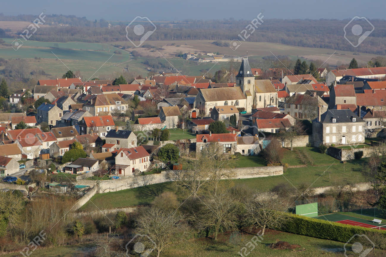 Omerville, France - January 03, 2010: Aerial view of Omerville, a small rural village of Vexin grouped around its church, in Val-d'Oise department (95420), Ile-de-France region - 164841122