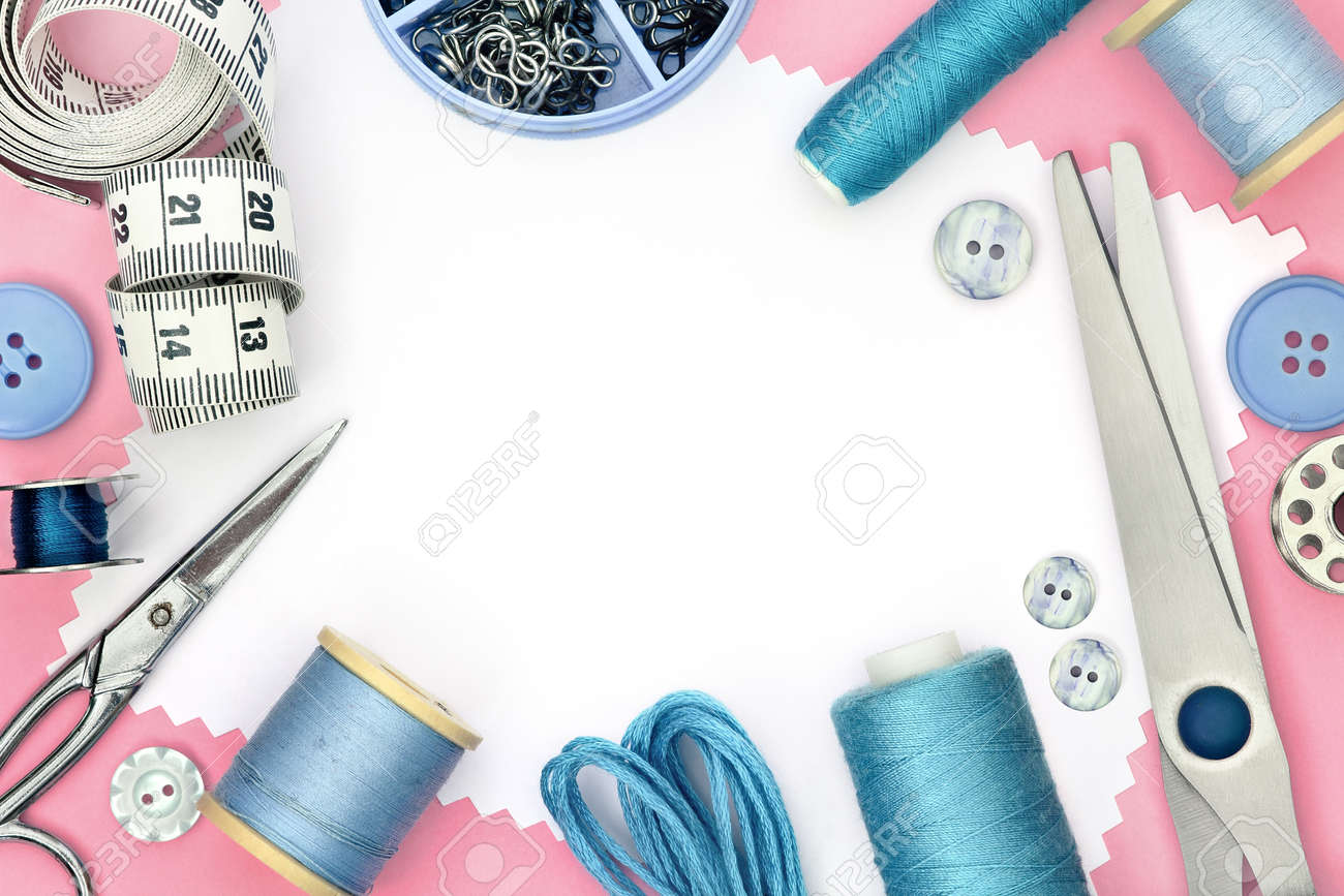 Pink template for sewing product with white background and set of seamstress tools, scissors, tape measure, button and spool of threads - 165250177