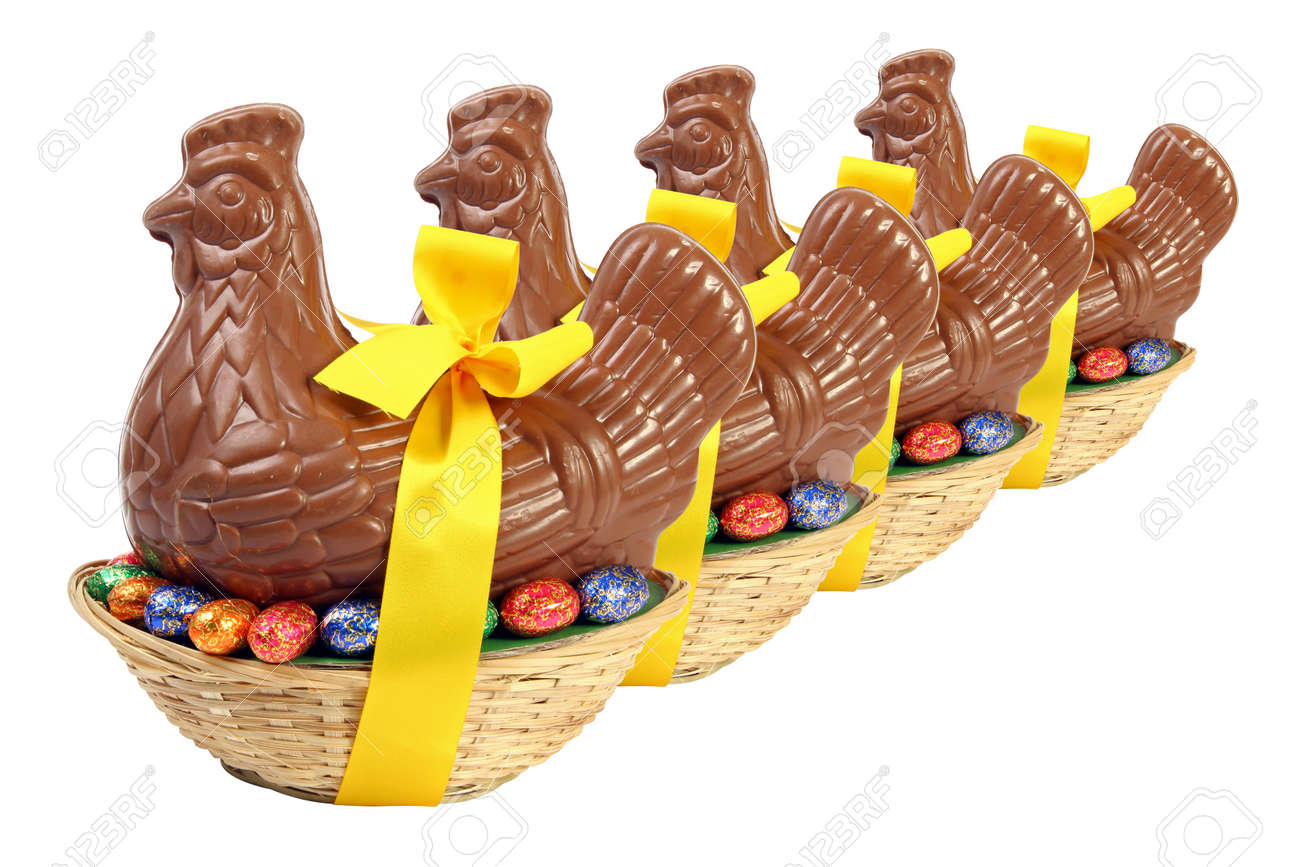 Set of chocolate Easter hen and chicken with yellow ribbon and bow, presented in a basket with decorative eggs, cut out and isolated on white background - 166000613