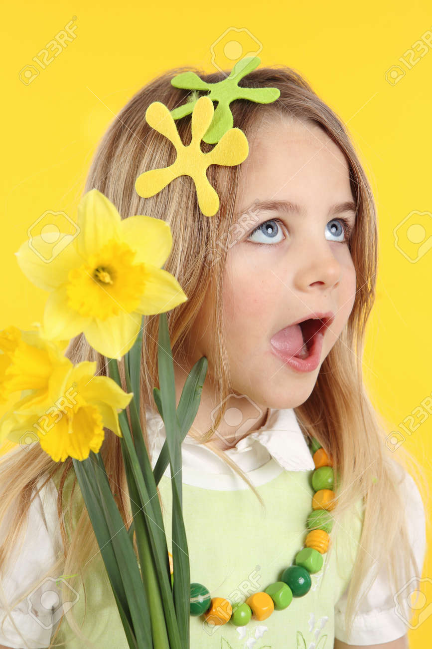 Portrait little girl with daffodils for spring festival on yellow background. - 166404001